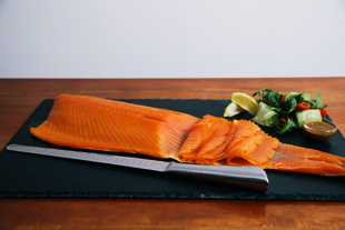 Hand sliced whole side of traditional cold smoked salmon