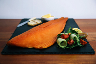 Unsliced whole side of traditional cold smoked salmon